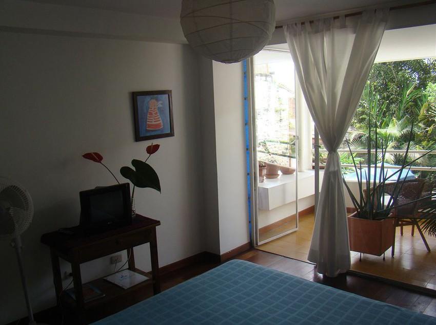 Jardin azul casa cali partir de 11 destinia for Casa jardin hotel