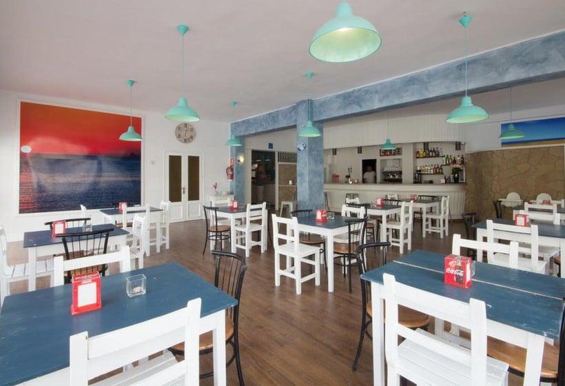 مطعم NWT Hostal Sunset Ibiza سان أنطونى دى بورتمانى